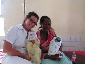 Midwifery student, Angela Resendes (left) with a Ugandan mother (right) and her newborn twins