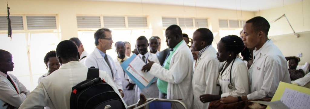 Piotr Blachut teaches residents on the patient ward at Mulago Hospital in Kampala, Uganda.