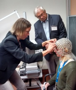 Dr. Christine Tipper, Assistant Professor of Psychiatry, fits the EEG onto a psychiatry student for a demonstration.